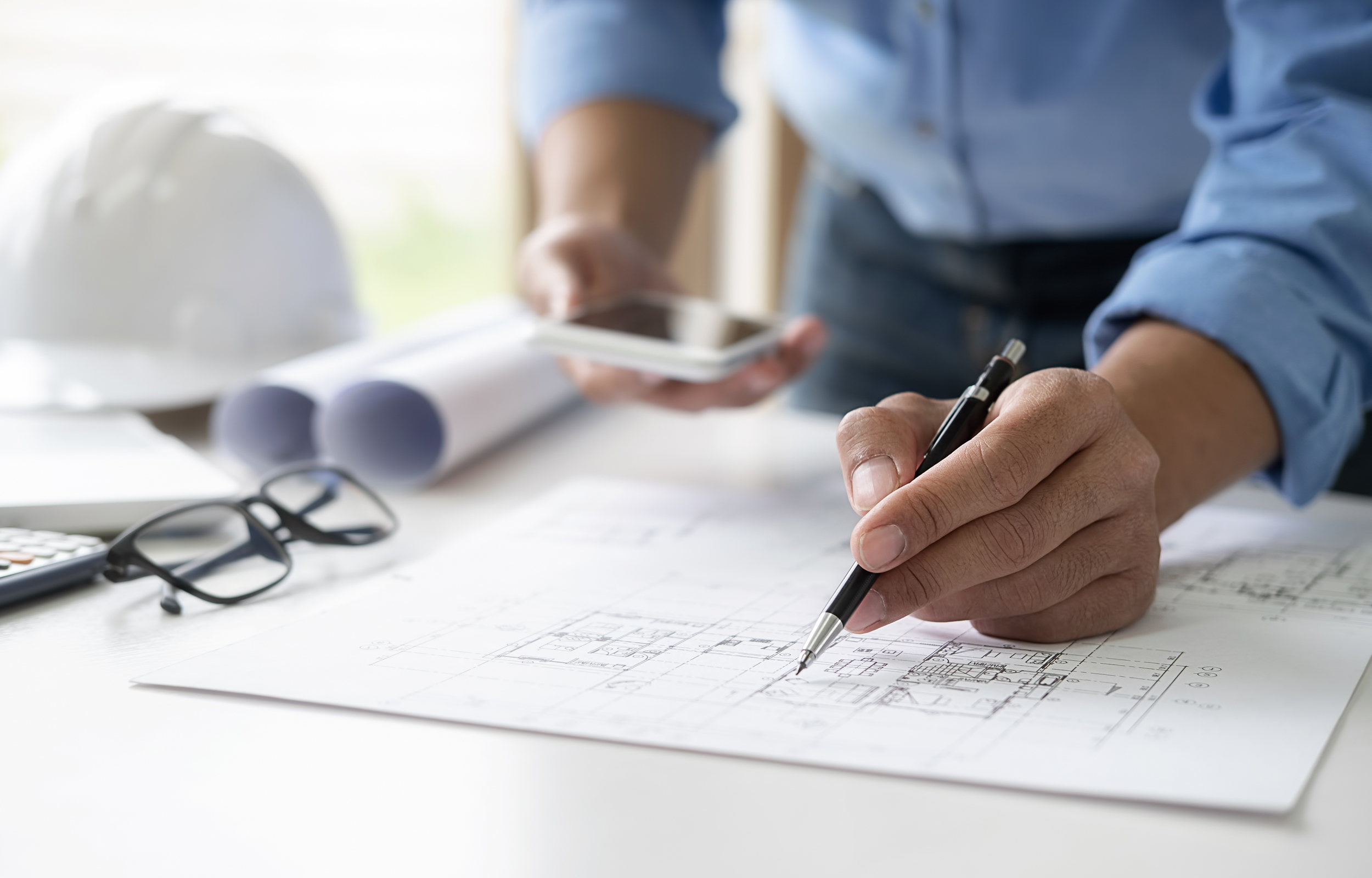 Architect or Engineer working in office with engineering tools,