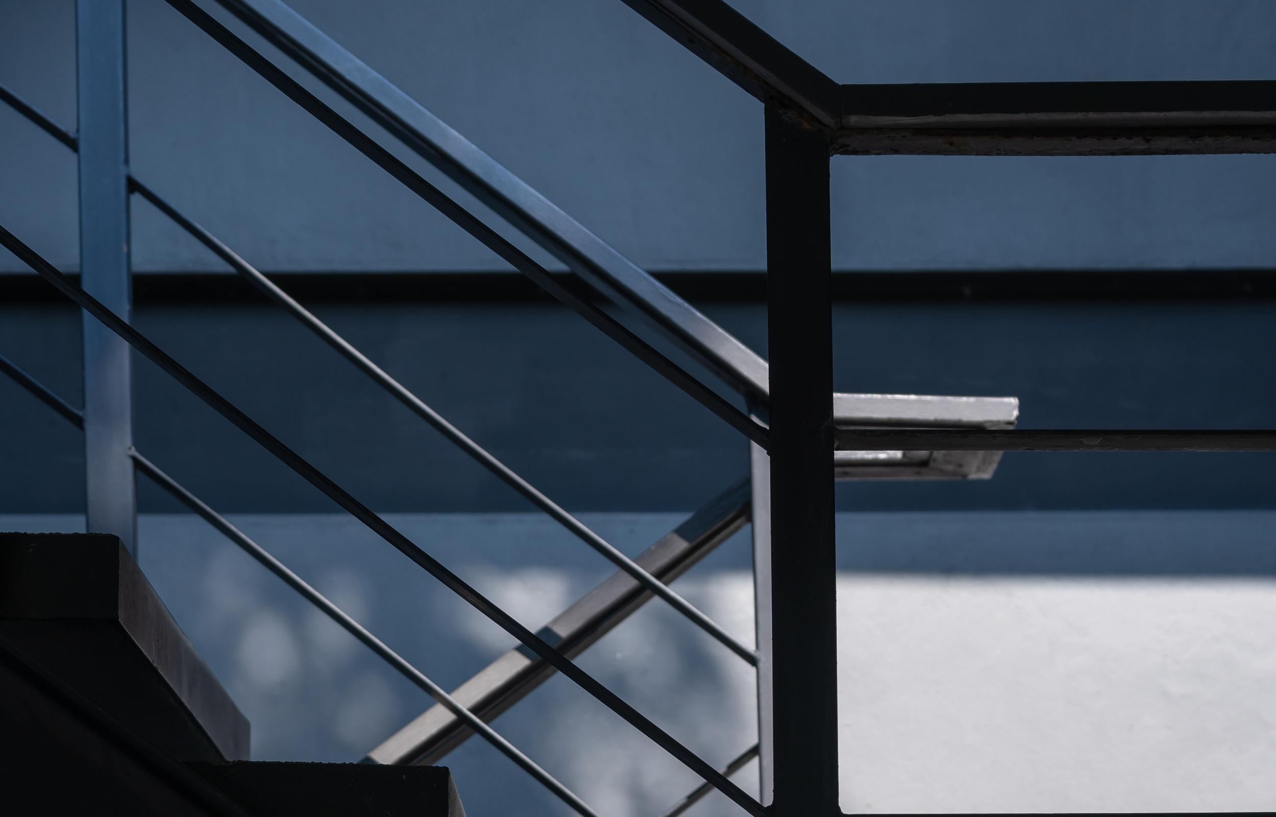 Stairway with black metallic banister modern building architectu