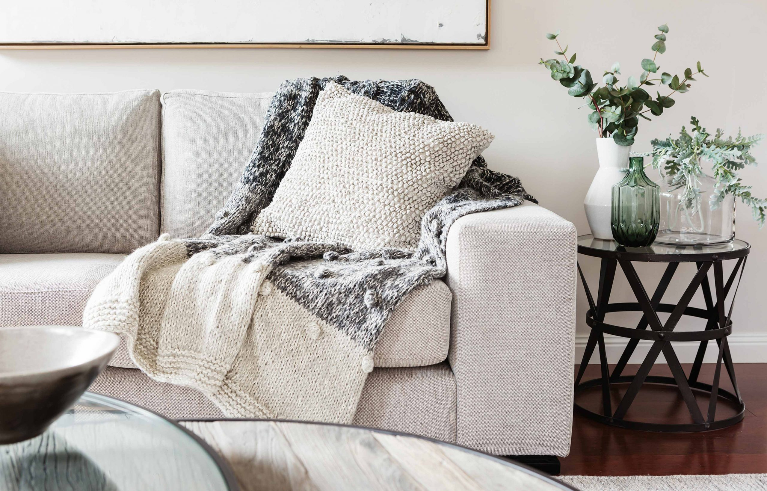 Textured layers interior styling of cushion sofa dn throw in nue